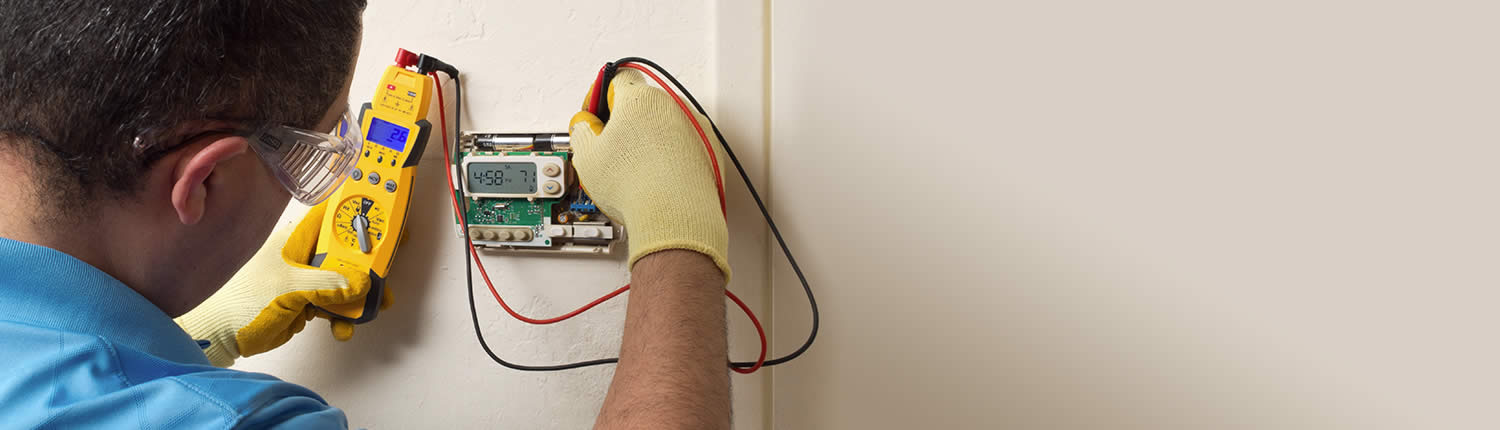 Residential thermostat testing and repair by Apex Heating and Air Conditioning